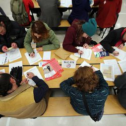 Voters fill out ballots at a Democratic caucus at Emerson Elementary School in Salt Lake City on Tuesday, March 22, 2016.