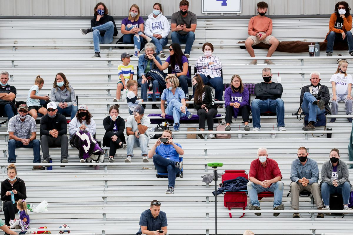 """Lehi fans watch a girls soccer game between Lehi and Timpanogos in Lehi on Tuesday, Oct. 13, 2020. Due to a surge in new cases of COVID-19, state officials on Tuesday announced masks will now be required across the state """"anywhere people congregate together for an event."""""""