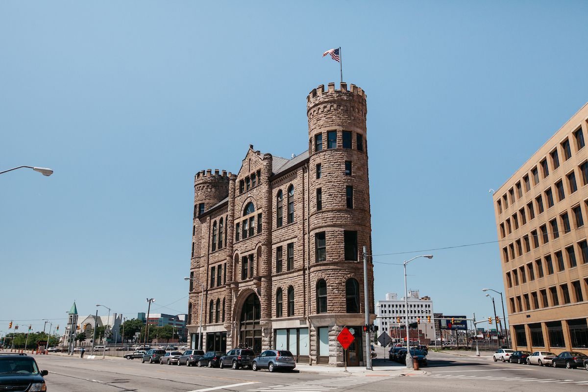 The exterior of the Grand Army of the Republic Building in Detroit. The building is brown brick with towers and resembles a castle.