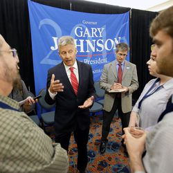 Libertarian presidential candidate Gary Johnson, center, speaks to supporters and delegates at the National Libertarian Party Convention, Friday, May 27, 2016, in Orlando, Fla.