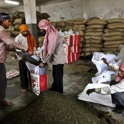 In this photo taken Tuesday, April 17, 2012, Indian workers pack green tea at a factory in Amritsar, India. Decades of conflict have decimated trade between the two nuclear armed South Asian neighbors. Now, with peace efforts between the rivals stalled, officials are hoping that trade could lead the way to easing tensions. They have liberalized their commercial ties, inaugurated a new border depot and promised to throw open their economies to each other by the end of the year.