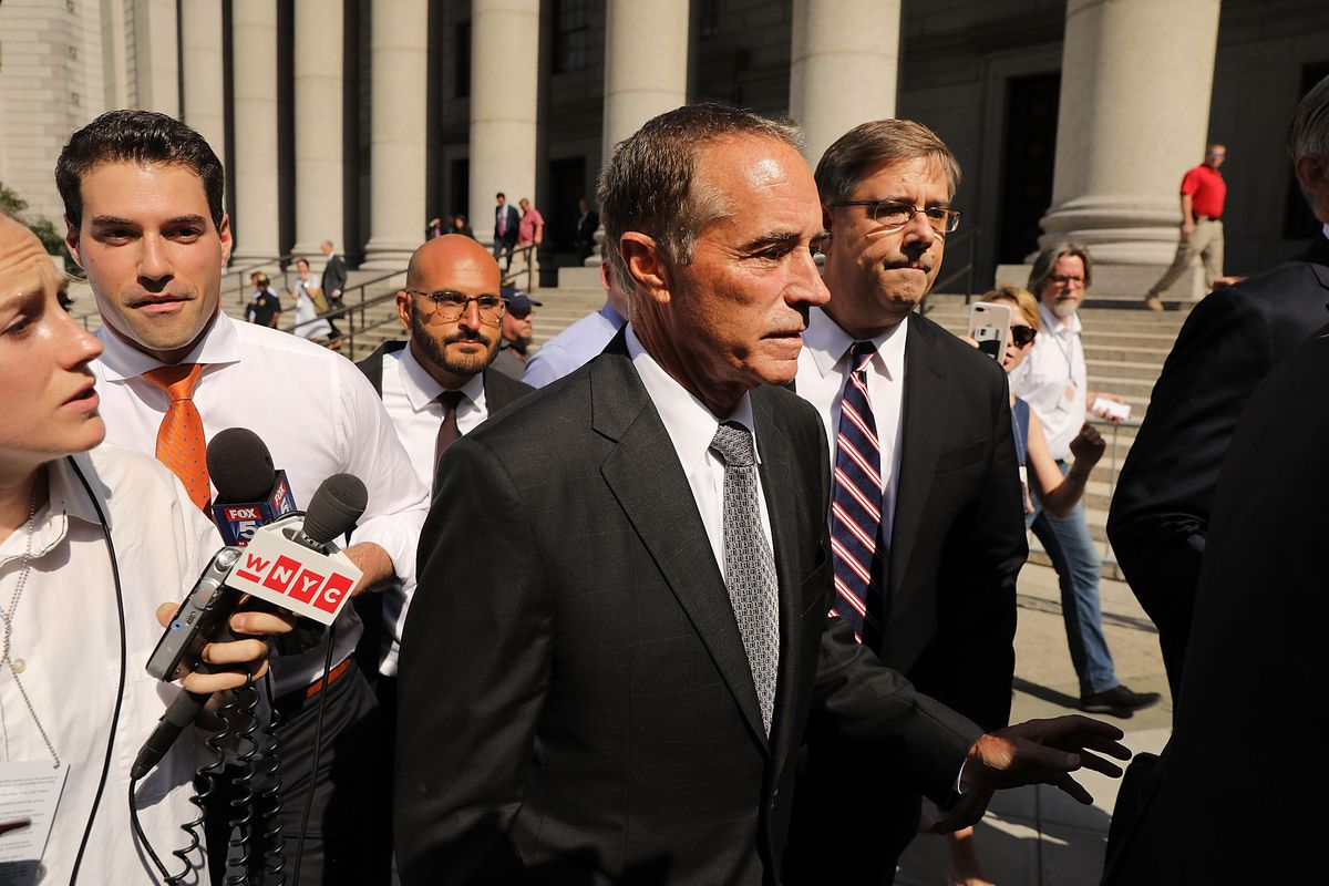 Rep. Chris Collins walks out of a New York court house after being charged with insider trading on August 8, 2018 in New York City.