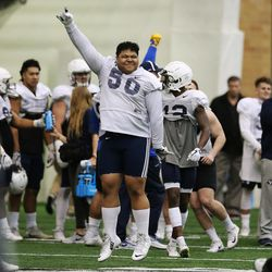 Brigham Young Cougars defensive lineman Tevita Mo'unga (50) cheers a good defensive play during an intersquad scrimmage in Provo on Friday, March 23, 2018.