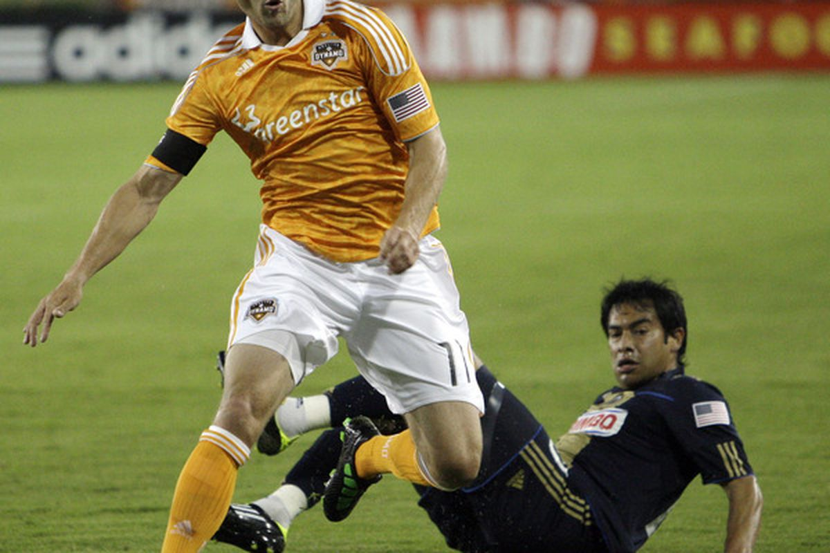 HOUSTON - MARCH 19:  Brad Davis #11 of the Houston Dynamo goes around Carlos Ruiz #20 of the Philadelphia Union  in the first half at Robertson Stadium on March 19, 2011 in Houston, Texas.  (Photo by Bob Levey/Getty Images)
