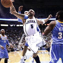 Carlos Boozer (5) of the Utah Jazz  fights with Kenyon Martin (4) of the Denver Nuggets.