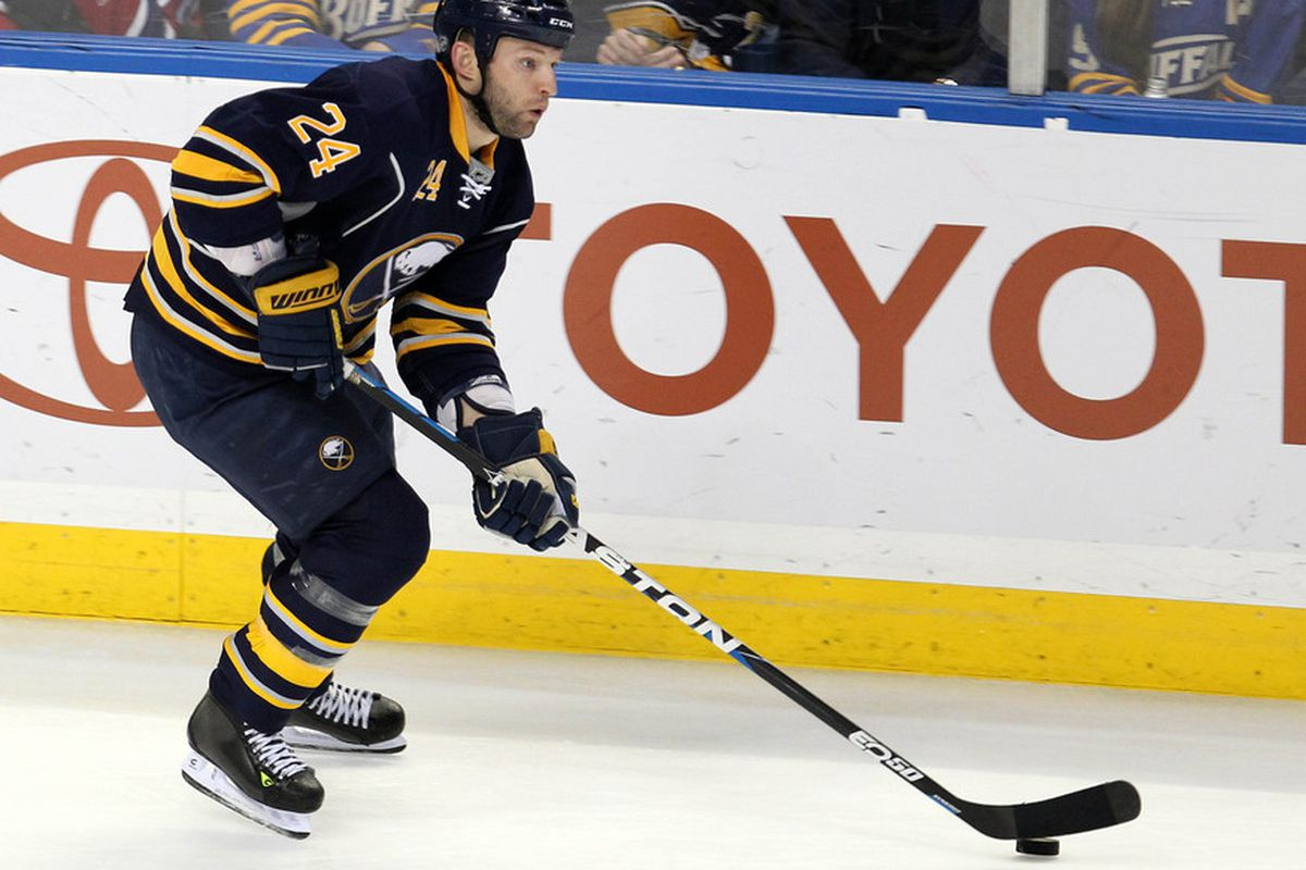 Mar 12, 2012; Buffalo, NY, USA;  Buffalo Sabres defenseman Robyn Regehr (24) skates with the puck against the Montreal Canadiens at the First Niagara Center.  Mandatory Credit: Timothy T. Ludwig-US PRESSWIRE