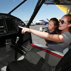 Tara Hardinger hods daughter Trinelle so she can get a better look inside an airplane during the Skypark Aviation Festival and Expo at Skypark Airport in Woods Cross on Friday, June 2, 2017. The expo is Utah's largest annual aviation event.
