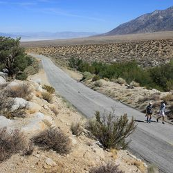 Jay Smithberger (R) of Granville, Ohio ascends Whitney Portal Road toward the finish of the AdventurCORPS Badwater 135 ultra-marathon race