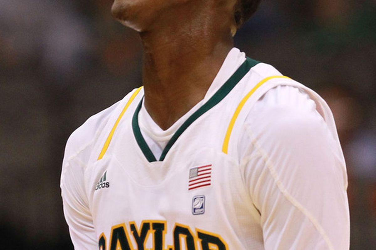 DALLAS, TX - DECEMBER 28:  Quincy Miller #30 of the Baylor Bears reacts during play against the Mississippi State Bulldogs at American Airlines Center on December 28, 2011 in Dallas, Texas.  (Photo by Ronald Martinez/Getty Images)