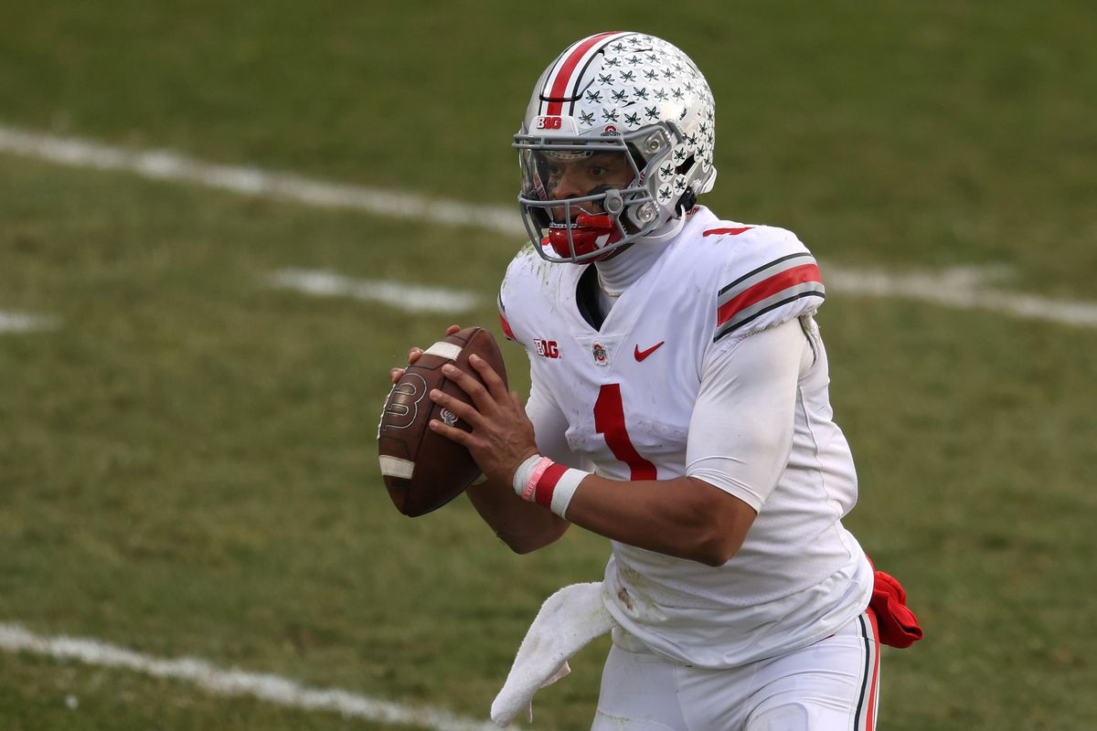 Justin Fields of the Ohio State Buckeyes looks to pass in the second half against the Michigan State Spartans at Spartan Stadium on December 05, 2020 in East Lansing, Michigan. Ohio State won the game 52-12.