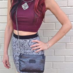 The best-selling Bianca Rachele (Di Pietro's own label) open-back crop top ($38) is styled here with a Cozen NYC printed floral mini skirt, $42; Debil Leather Goods chain crossbody bag, $235; Ellen Durkan laser cut metal necklace, $120.