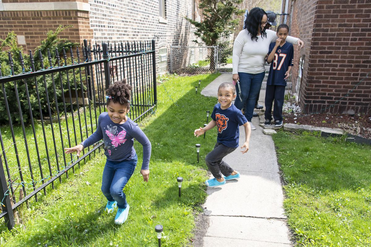 Natasha Norwood, left, is chased around by her brother John-Michael in the front yard of the Norwood family home, Tuesday, April 28, 2020.