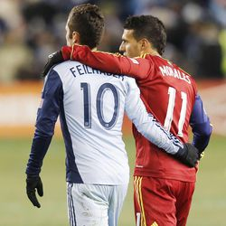 Sporting's Benny Feilhaber and Real's Javier Morales walk off the pitch at the end of regulation as Real Salt Lake and Sporting KC play Saturday, Dec. 7, 2013 in MLS Cup action. Sporting KC won in a shootout.