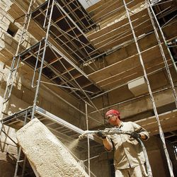 Doug Henriksen sprays cement on a piece of foam that is to be the stone covering the tomb of Jesus at the New Testament movie set of The Church of Jesus Christ of Latter-day Saints in Goshen. Monday, Aug. 1, 2011.