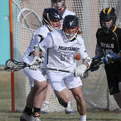Mountain Crest's Tyson Kropf cradles and runs with the ball in a lacrosse game against Roy in the Battle at the Beet boys lacrosse tournament at Jordan High School in Sandy on Friday, March 12, 2021.