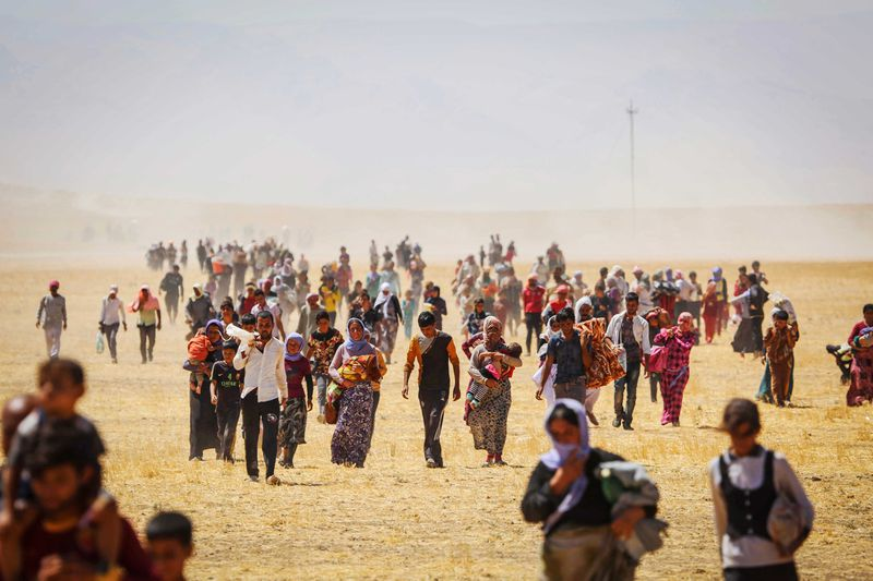 Thousands of Yezidis trapped in the Sinjar mountains as they tried to escape from Islamic State (IS) forces, are rescued by Kurdish Peshmerga forces and Peoples Protection Unit (YPG) in Mosul, Iraq on August 9, 2014.