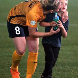 Utah Royals FC forward Amy Rodriguez (8) kisses her son Ryan after a match against the Orlando Pride at Rio Tinto Stadium in Sandy on Wednesday, May 9, 2018.