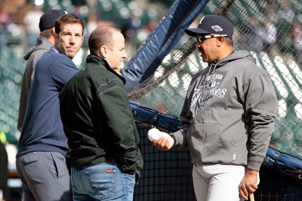 Billy Eppler (left), seen here with Brian Cashman and Tony Pena in 2012.