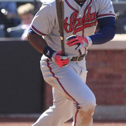 Atlanta Braves' Jason Heyward watches his two-run double during the seventh inning of a baseball game against the New York Mets on Sunday, April 8, 2012, in New York.