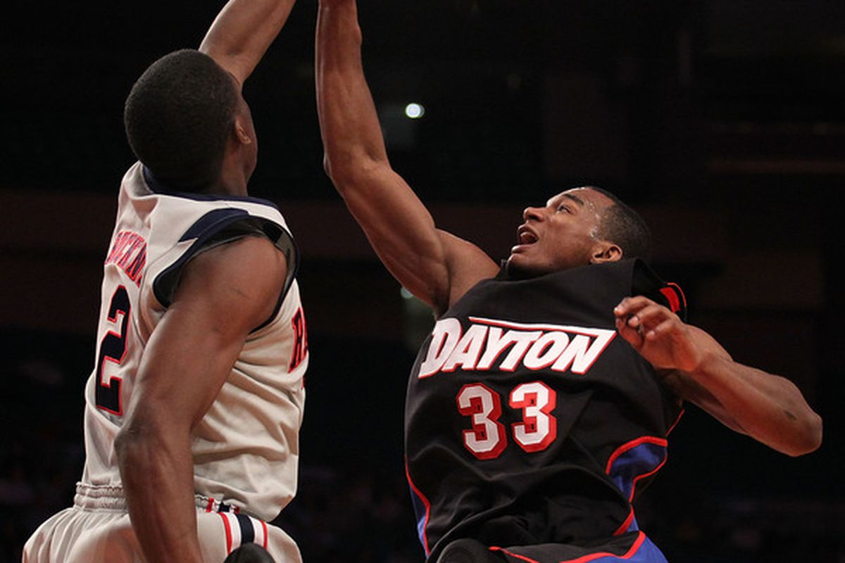 NEW YORK - MARCH 30:  Chris Wright #33 of the Dayton Flyers has his shot blocked by Reginald Buckner #2 of Ole Miss during their semi final at Madison Square Garden on March 30, 2010 in New York, New York.  (Photo by Nick Laham/Getty Images)