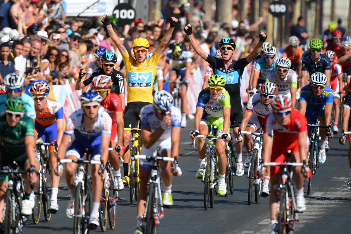 July 22, 2012; Paris, FRANCE; Bradley Wiggins (GBR), in yellow, celebrates after crossing the finish line to win the 2012 Tour de France in Paris.  Mandatory Credit: Jerome Prevost/Presse Sports via US PRESSWIRE
