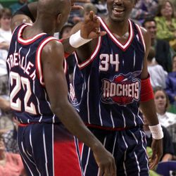 Houston Rockets Clyde Drexler and Hakeem Olajuwon celebrate their victory over the Utah Jazz during the final minutes of Thursday's game, April 23, 1998 at the Delta Center.  PHOTO BY CHUCK WING/DESERET NEWS