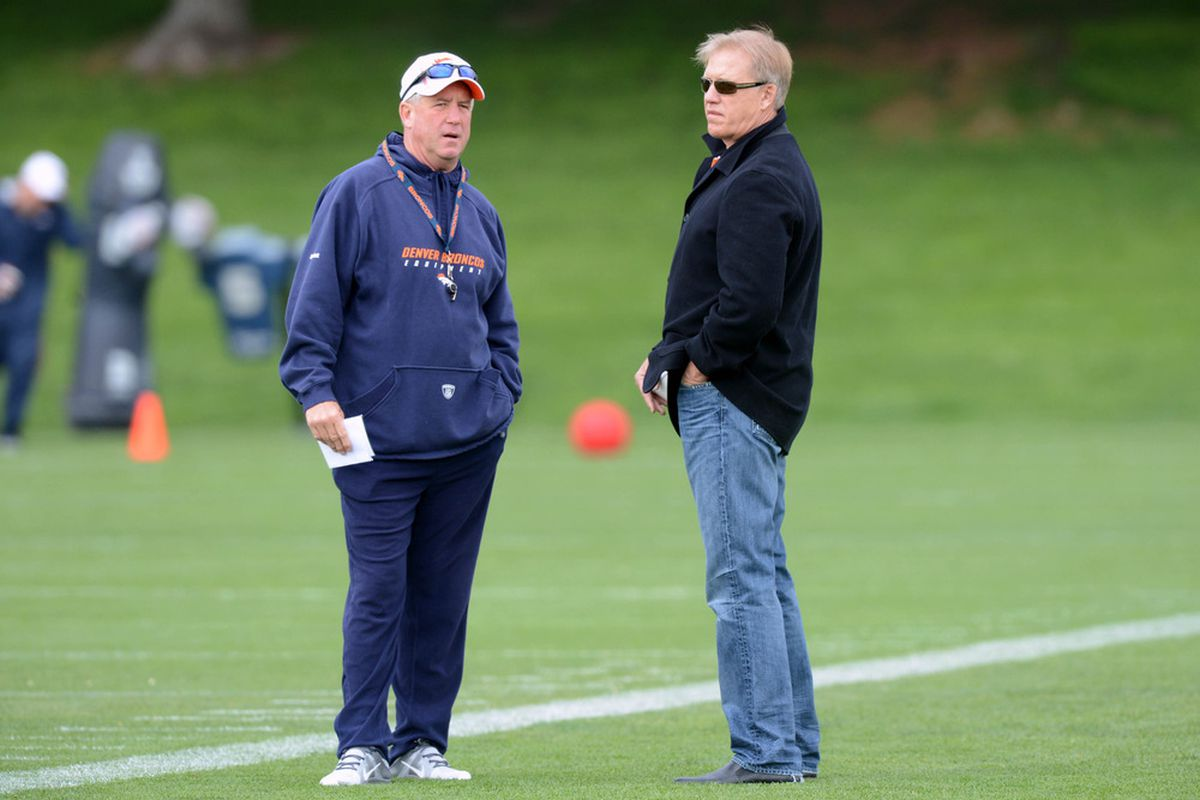 May 13 2012; Englewood, CO, USA; Denver Broncos head coach talks with executive vice president of football operations John Elway during mini camp at Broncos headquarters. Mandatory Credit: Ron Chenoy-US PRESSWIRE