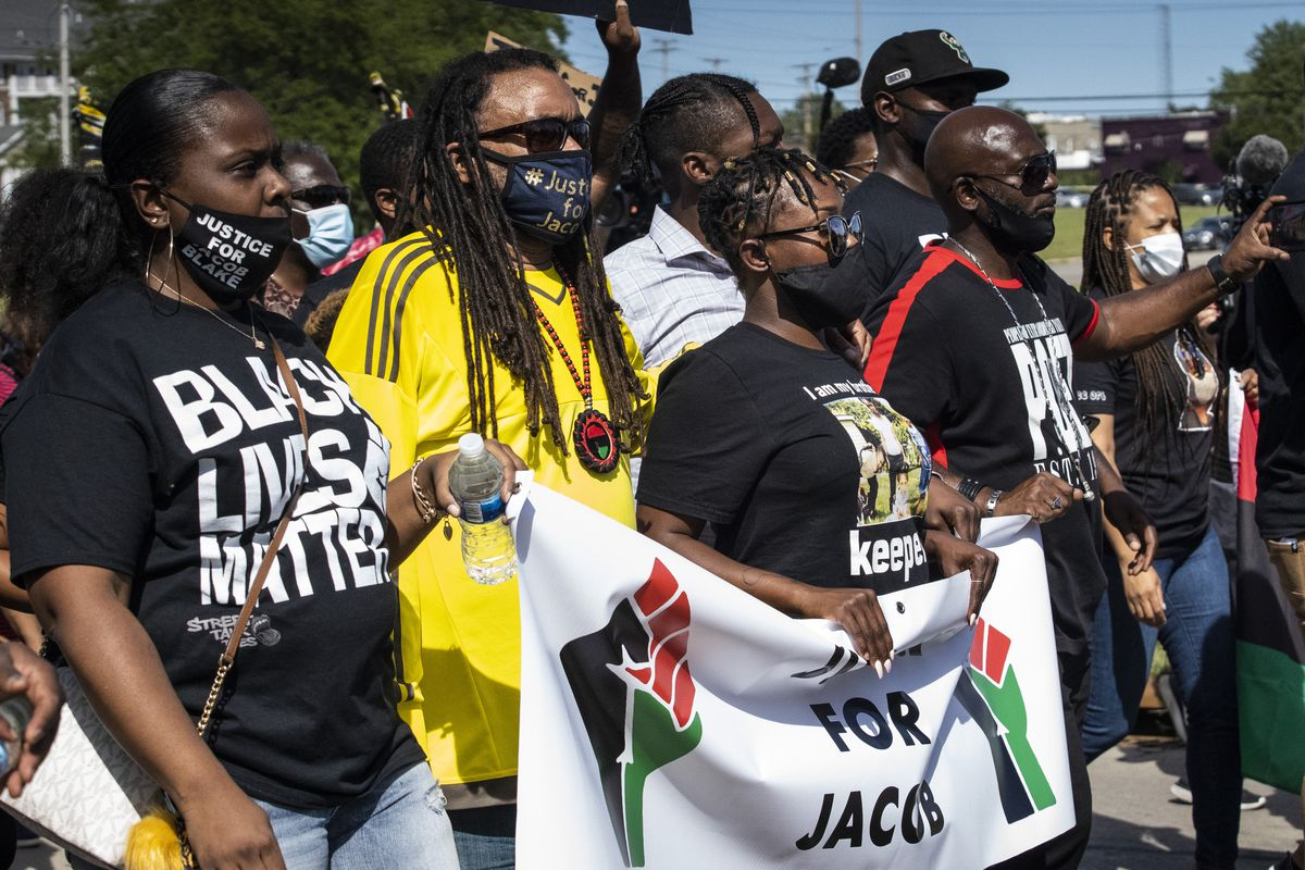 Justin Blake and Letetra Wideman, Jacob Blake's uncle and sister, join other family members and hundreds of supporters in a march to march through the streets of Kenosha, six days after Jacob Blake was shot in the back by a police officer in the Wisconsin city, Saturday, Aug. 29, 2020.