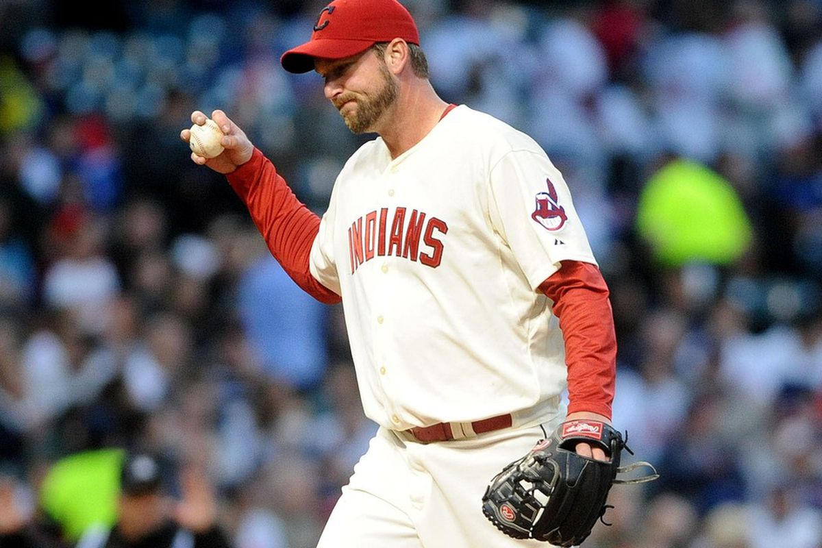 May 5, 2012; Cleveland, OH, USA: Cleveland Indians starting pitcher Derek Lowe (26) reacts after giving up a base hit against the Texas Rangers during the game at Progressive Field.  Mandatory Credit: Eric P. Mull-USPRESSWIRE