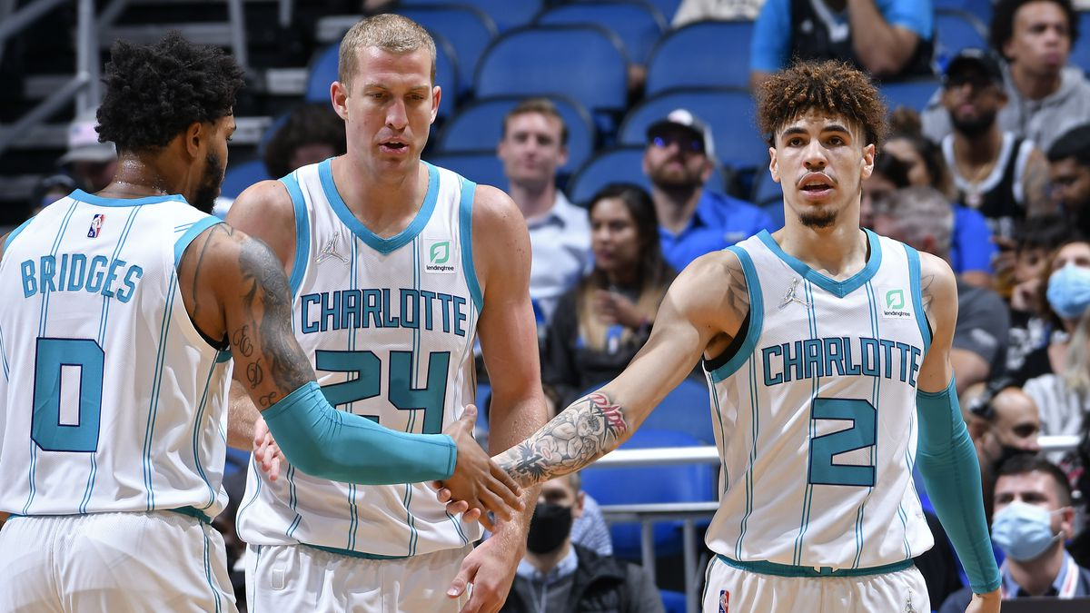 LaMelo Ball #2 and Miles Bridges #0 of the Charlotte Hornets shake hands against the Orlando Magic on October 27, 2021 at Amway Center in Orlando, Florida.