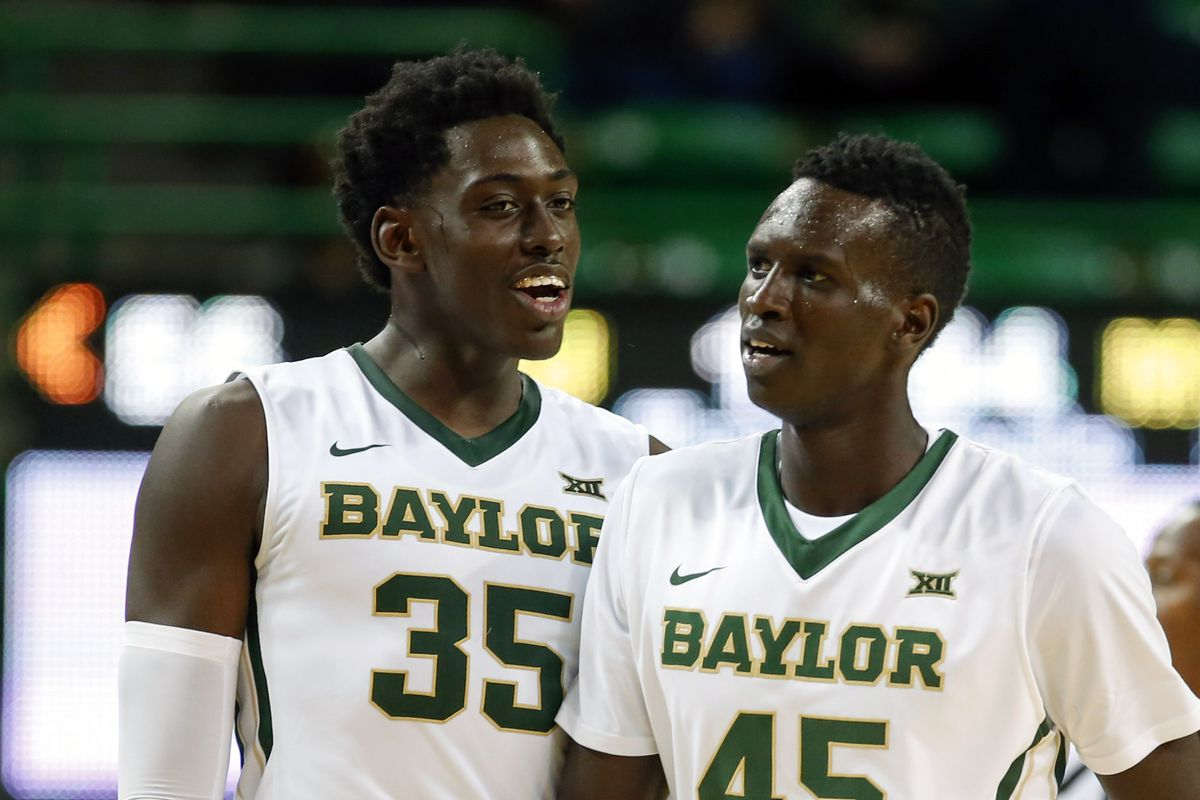 Jonathan Motley and Deng Deng take a breather against McNeese State