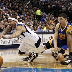 Dallas Mavericks' Delonte West, left, trips while driving to the basket on Golden State Warriors' Klay Thompson (11) in the first half of an NBA basketball game Friday, April 20, 2012, in Dallas.