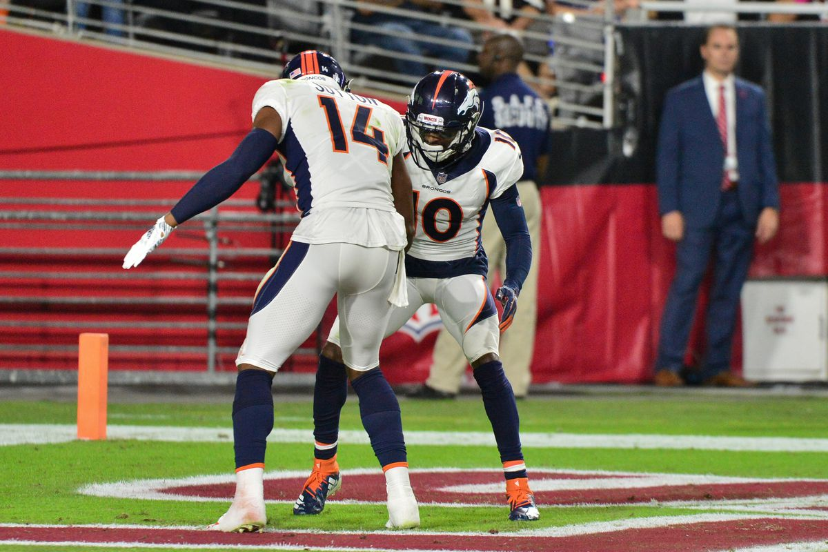 Denver Broncos wide receiver Emmanuel Sanders celebrates with wide receiver Courtland Sutton after scoring a touchdown during the first half against the Arizona Cardinals at State Farm Stadium.