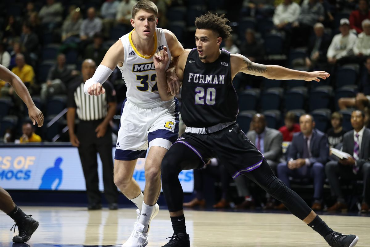 Furman Paladins forward Jalen Slawson blocks out Chattanooga Mocs guard Matt Ryan during the college basketball game between Furman and UT-Chattanooga on Jan. 08, 2020 at McKenzie Arena in Chattanooga, TN.