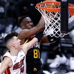 Utah Jazz guard Miye Oni (81) is fouled by Miami Heat guard Tyler Herro (14) at the rim as the Utah Jazz and the Miami Heat play an NBA basketball game at Vivint Smart Home Arena in Salt Lake City on Saturday, Feb. 13, 2021. Utah won 112-94.