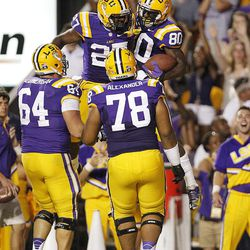 LSU wide receiver Jarvis Landry (80)  celebrates his touchdown reception with running back Kenny Hilliard (27)  in the first half of their NCAA college football game against Idaho in Baton Rouge, Saturday, Sept. 15, 2012.