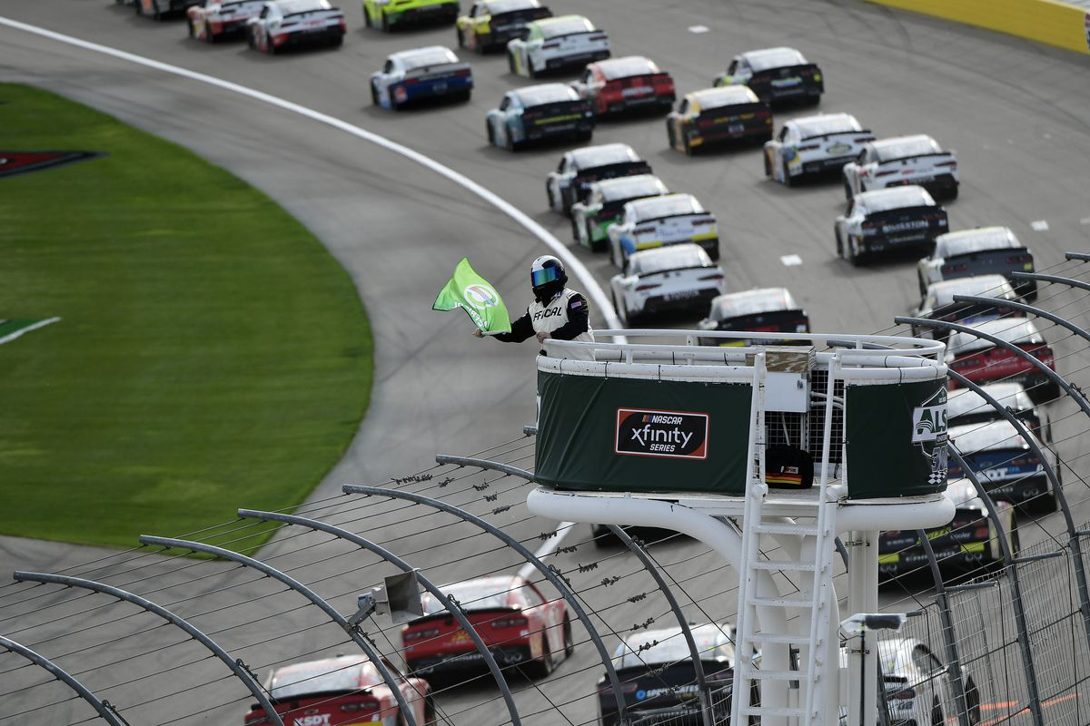A NASCAR official waves the green flag following a caution during the NASCAR Xfinity Series Alsco Uniforms 300 Saturday March 6, 2021 at Las Vegas Motor Speedway in Las Vegas, Nevada.