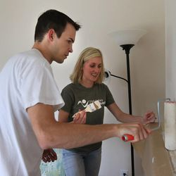 Newlyweds Jason, 27, and Emily Brand, 26, do some touch-up painting at their new home July 20, 2015, in Holladay. A new study from University of Utah professor Nicholas Wolfinger shows that those who tie the knot after their early 30s are now more likely to divorce than those who marry in their late 20s.