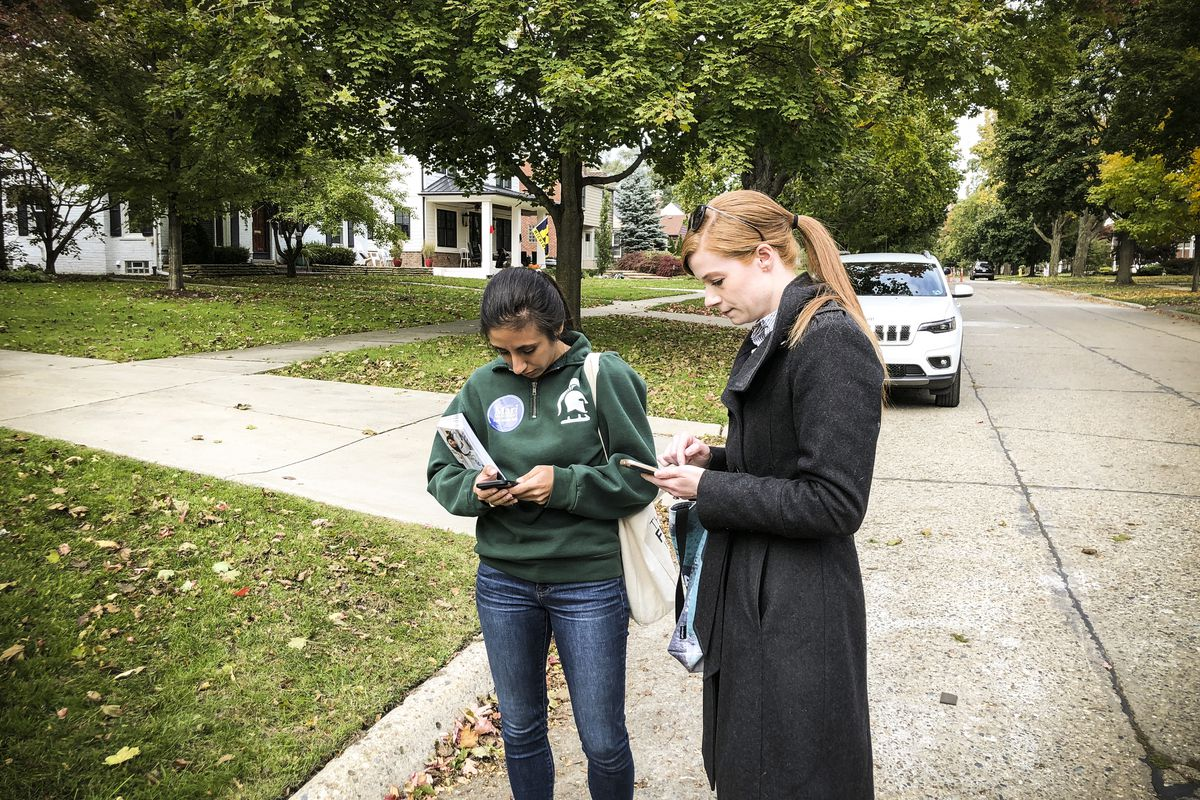 Michigan State House of Representatives candidate Mari Manoogian, left, and Michigan State Senate candidate Mallory McMorrow, right, canvassing in Birmingham, Michigan, on October 19, 2018