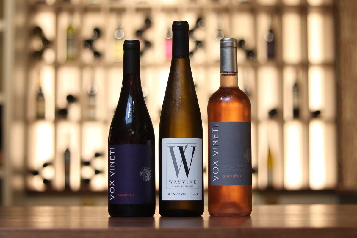 three wine bottles in a row