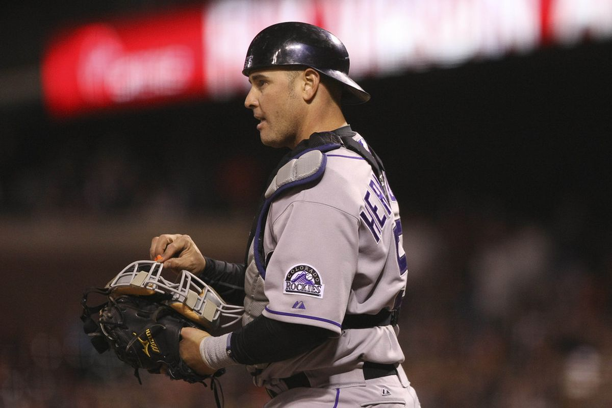 May 15, 2012; San Francisco, CA, USA; Colorado Rockies catcher Ramon Hernandez (55) checks his mask after being struck in the face against the San Francisco Giants during the seventh inning at AT&T Park. Mandatory Credit: Kelley L Cox-US PRESSWIRE