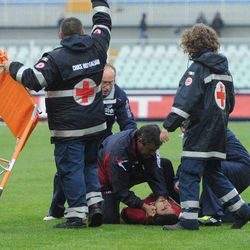 Medics assist Livorno's Piermario Morosini as he lies on the turf after he collapsed during a Serie B soccer match between Pescara and Livorno, at Pescara's Adriatico stadium, central Italy, Saturday, April 14, 2012. Hospital officials say Morosini, who was on loan from Udinese, died after suffering cardiac arrest during his team's Serie B match at Pescara.