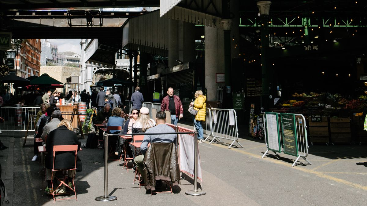 Guests sit at tables in Borough Market this week as London restaurants and pubs reopened for outdoor dining after four months of lockdown to halt the spread of coronavirus