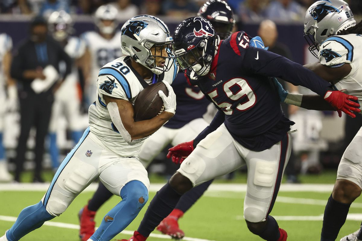 Carolina Panthers running back Chuba Hubbard (30) runs with the ball as Houston Texans defensive end Whitney Mercilus (59) attempts to make a tackle during the fourth quarter at NRG Stadium.