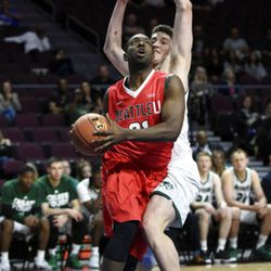 Seattle's William Powell (21) shoots against Utah Valley's Cory Calvert during the first half of an NCAA college basketball game in the first round of the Western Athletic Conference tournament Thursday, March 9, 2017, in Las Vegas. (AP Photo/David Becker)