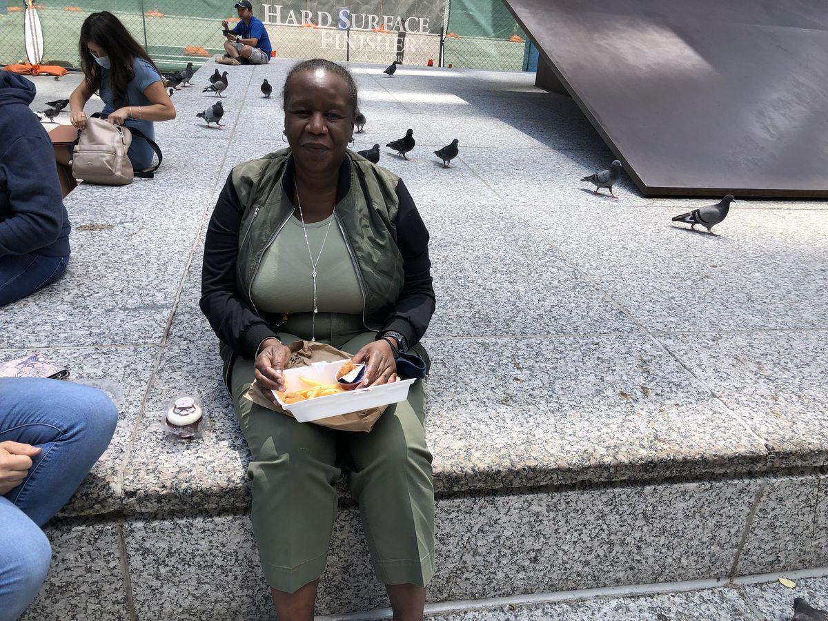 Alvalyn Neal-Gardner eats fried shrimp for lunch in Daley Plaza on Friday