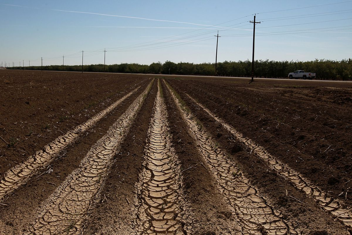 41345c4b6 Dried and cracked earth is visible on an unplanted field at a farm on April  29