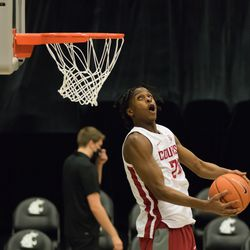PULLMAN, WA - NOVEMBER 28: Washington State guard Noah Williams (24) goes aerial for a dunk during warmups of the non-conference matchup between the Eastern Washington Eagles and the Washington State Cougars on November 28, 2020, at Beasley Coliseum in Pullman, WA.