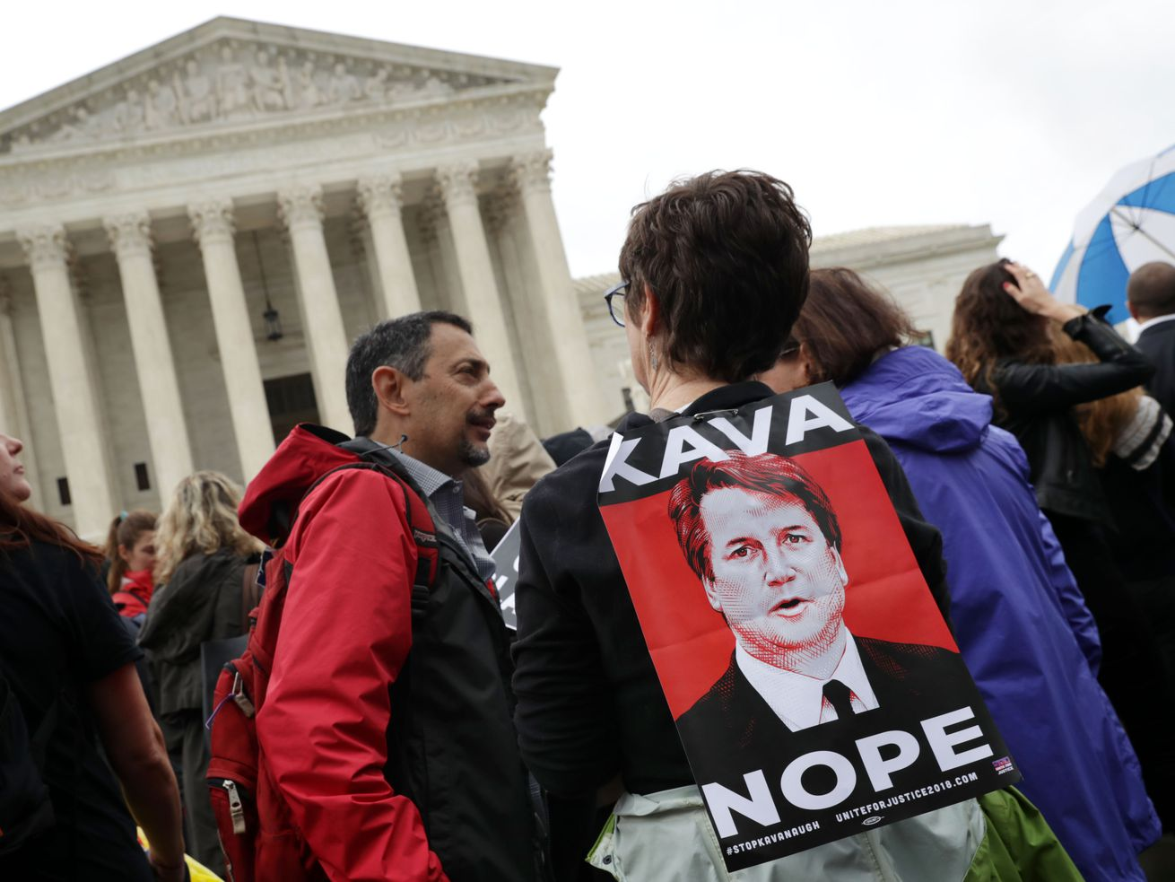 Protesters rally in front of the Supreme Court while demonstrating against the confirmation of Judge Brett Kavanaugh to the court on September 24, 2018.