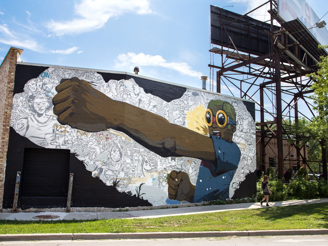 The building at 1400 W. Randolph Street features a mural by artist Hebru Brantley fronting Ogden Avenue.
